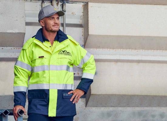 A tradie in branded hi-vis construction wear.
