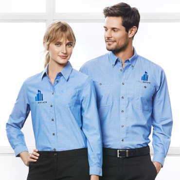 Two salesmen wearing relaxed-fit uniform shirts with embroidered logos.