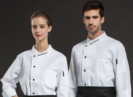 A male and female kitchen worker in custom chef whites