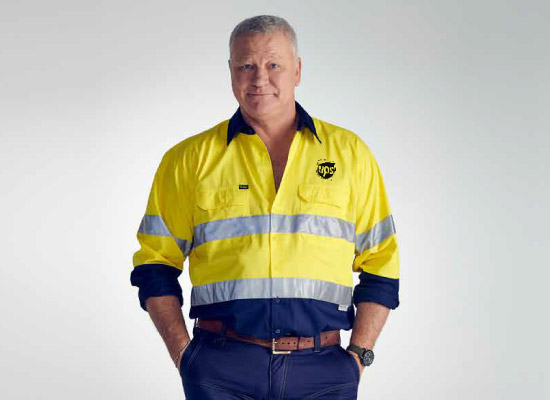 A factory or transport & logistics worker in a hi-vis shirt with a company logo on it.