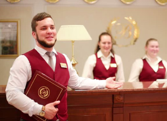 Hotel staff members in matching uniforms.